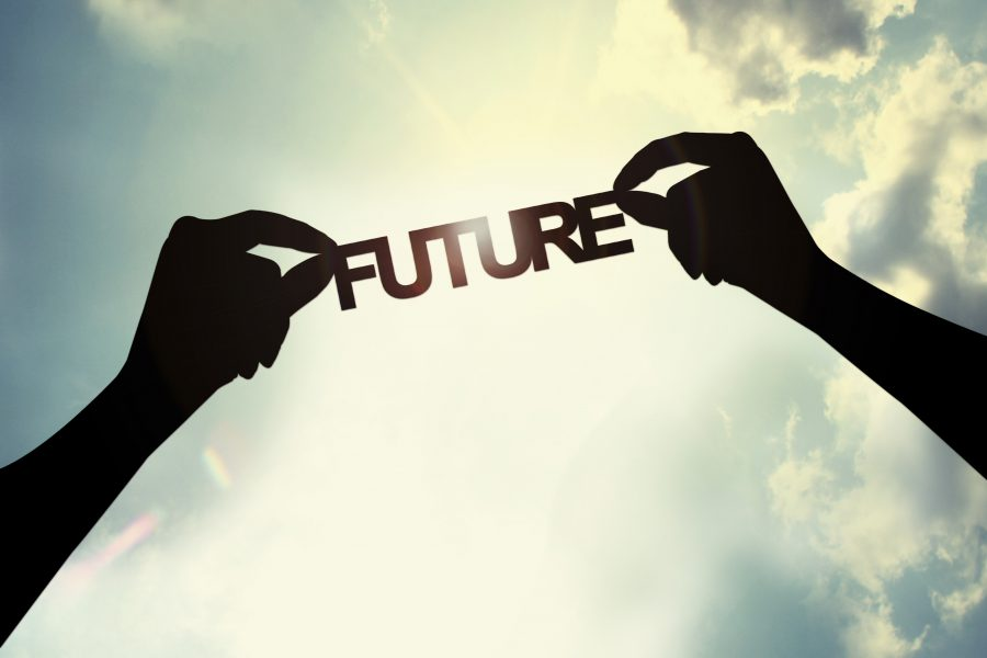 hands holding the word future up to the sky